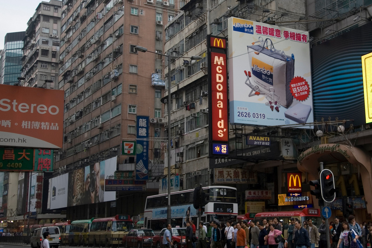 Large McDonald's sign at the center of a busy district in Kowloon, Hong Kong