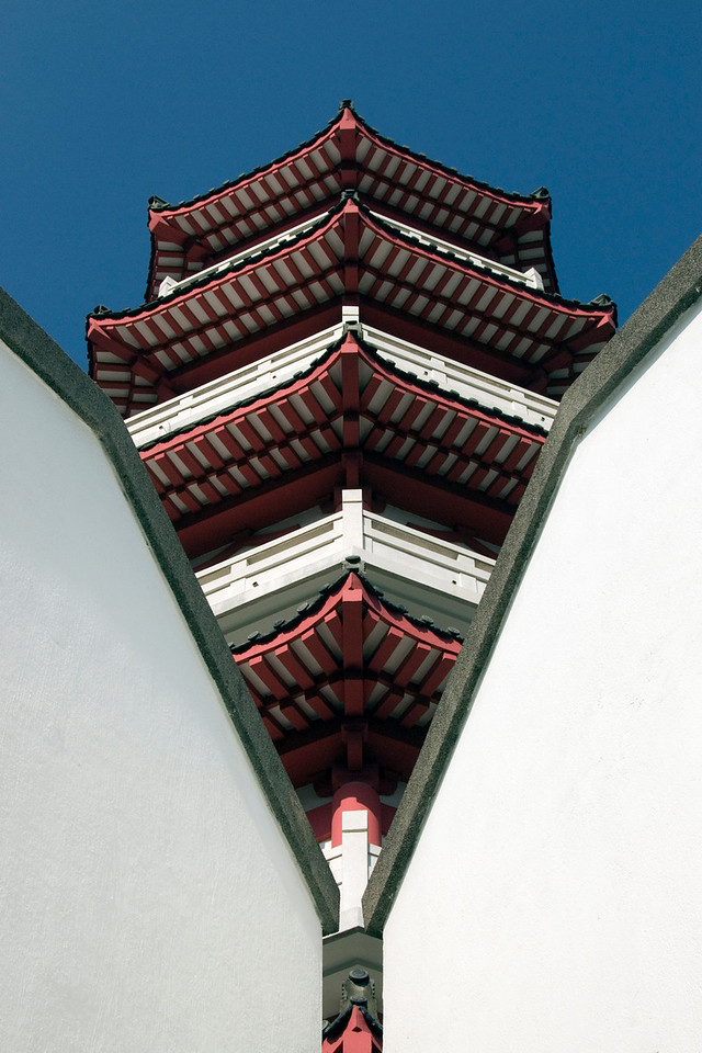 Shot of the pagoda roof in between walls inside the 10,000 Buddhas Temple