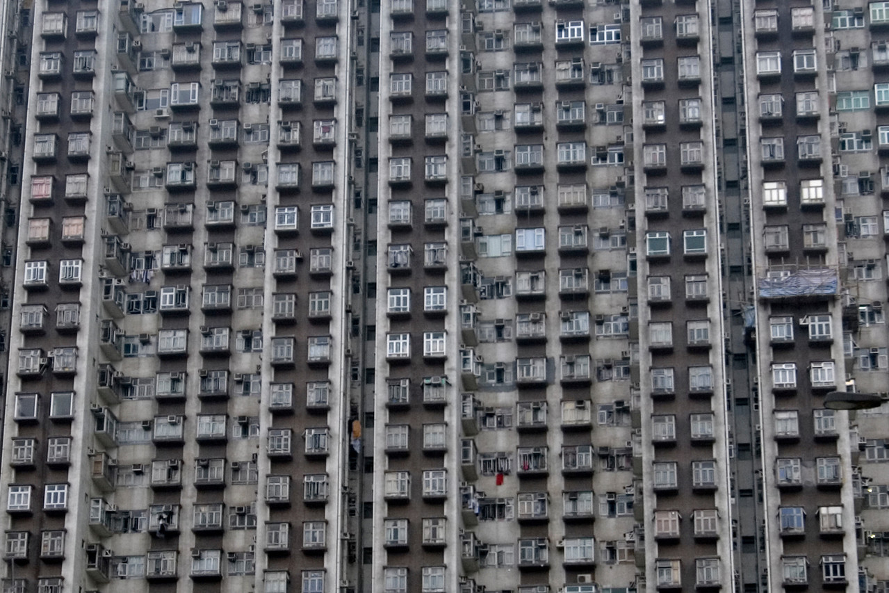 Rows of apartments at a building in Kowloon, Hong Kong