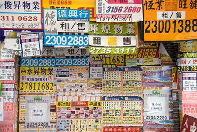 Wall covered with posters in Hong Kong