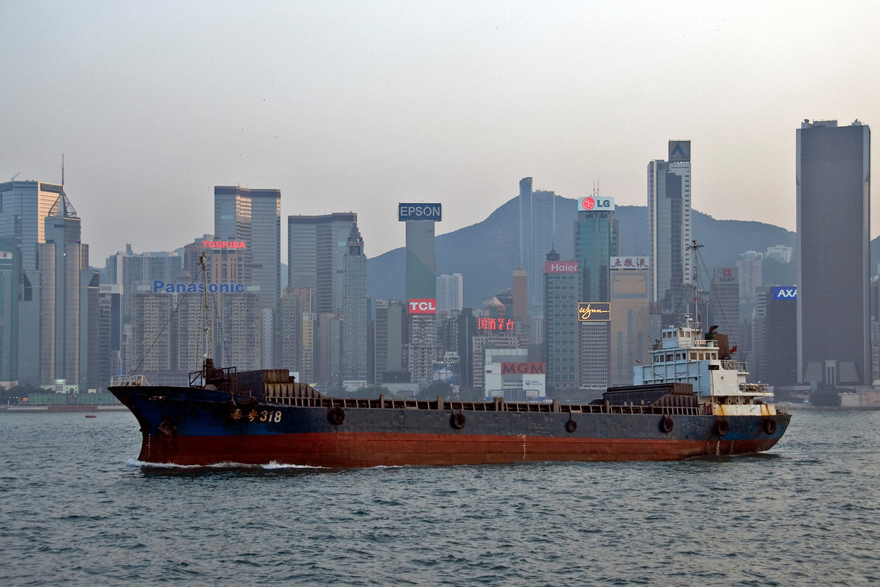 Cargo Ship cruising the Victoria Harbor in Hong Kong