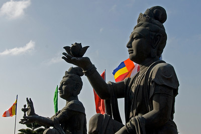 Statues of Buddha against a clear sky in Po Lin Temple, Hong Kong