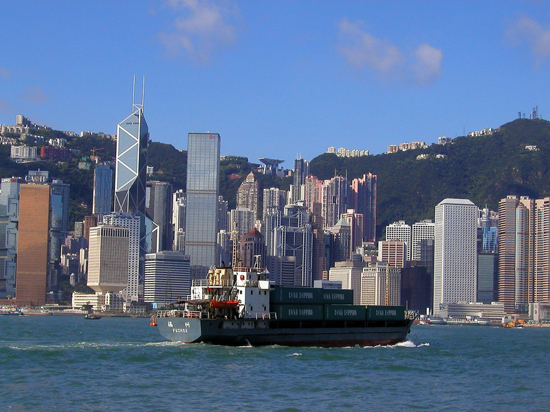Hong Kong Island skyline from Kowloon with freighter traffic - Aug 2002