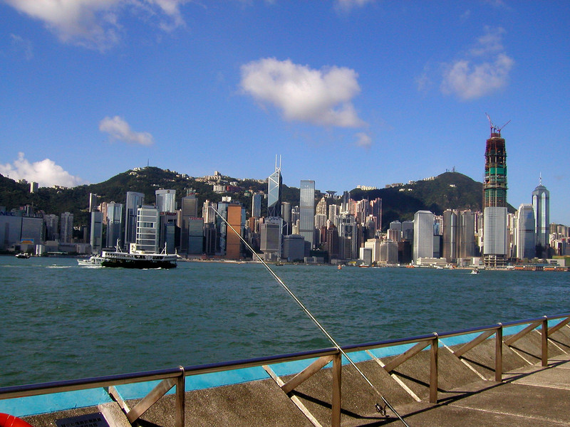 Hong Kong Island skyline from Kowloon and a lone fishing poll- Aug 2002