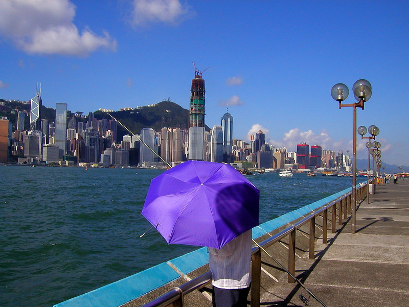 Hong Kong Island skyline from Kowloon and a man fishing - Aug 2002