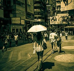 Some romance in busy HK street life scene.