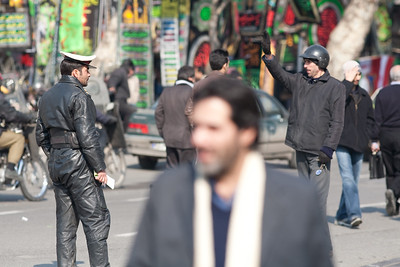 Tehran, Iran - February, 2008: Policeman in leather outside the busy Tehran Bazaar in the south of the city.  (Photo by Christopher Herwig)