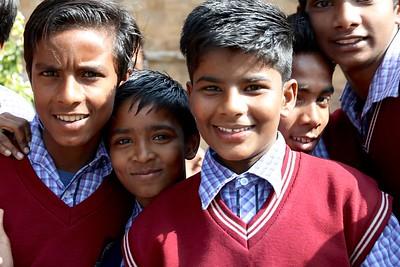 Friendly schoolboys on a field trip at Qutb Minar