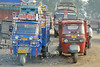 """Auto rickshaws ( just called """"auto"""") are common all over India, and provide cheap and efficient transportation. New auto richshaws run on CNG and are environment friendly. Typical mileage for an Indian-made auto rickshaw is around 82 miles per US gallon."""