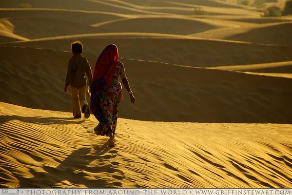 Desert Walkers At Sunset - Sam Sand Dunes - Jaisalmer, India