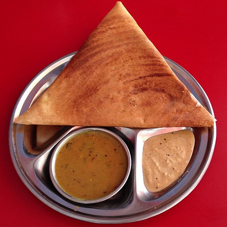 Masala dosa. One of our (South) Indian food favorites. Difficult to photograph, unless of course it sits atop a perfectly red table on the outskirts of Srinagar, Kashmir. #foodart