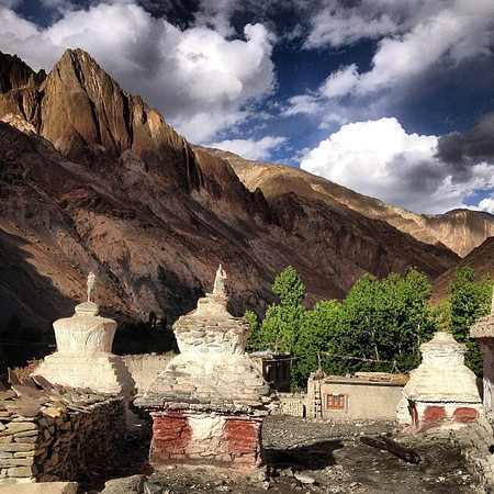 Late afternoon sky and Buddhist chortens in the village of Skiu -- a starting place for a visual spread of the Markha Valley trek, Ladakh