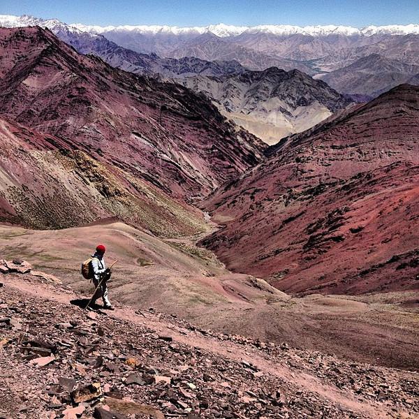 Stepping off Kongmaru La pass, 5130 meters overlooking layers of the Zanskar range and Karakorams. Day 6 peak experience, Markha Valley trek #Ladakh