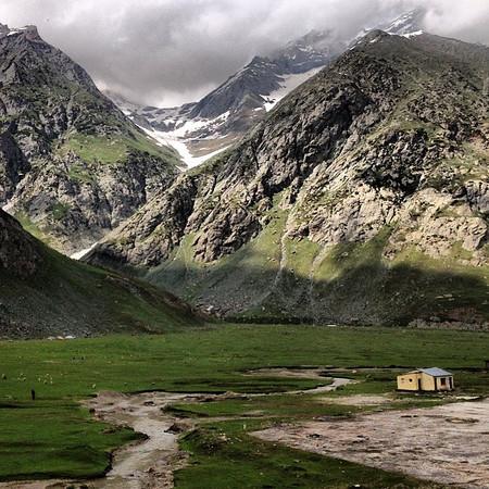 Wee house amidst the fog-shrouded mountains of #Kashmir