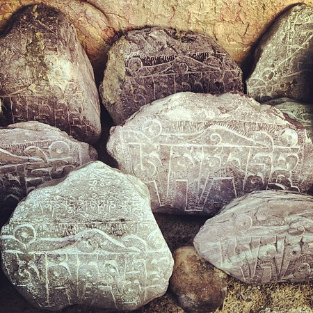 Tibetan Buddhist mani (engraved prayer stones) in the color of Himalayan rock. Atop Lamayuru Monastery #Ladakh