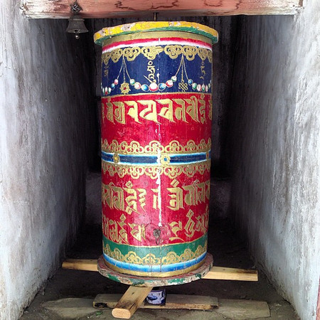The mani, a Tibetan Buddhist prayer wheel set amidst the millenium-aged monastery in Alchi, Ladakh.  A clockwise spin is said to be equivalent to a recitation of the prayer 'om mani padme hum'