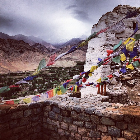 Buddhist prayer flags, weather brews around the monastery atop Tsemo Hill, Leh. #Ladakh