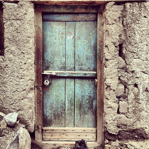 Favorite ancient doorway candidate #23. Down the dirt lane, a blue passage. Old Town Leh #Ladakh