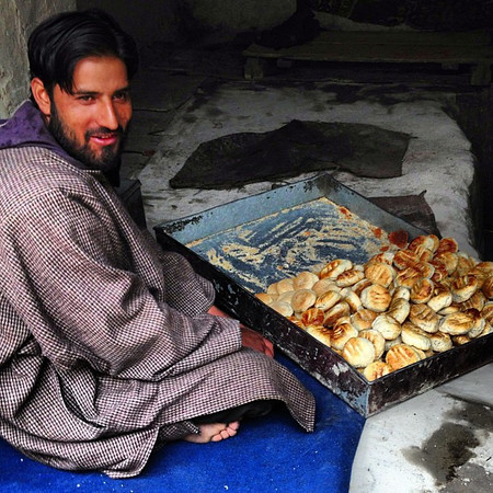 The afternoon bread man of old town Leh serves up Kashmiri-style rounds. #Ladakh