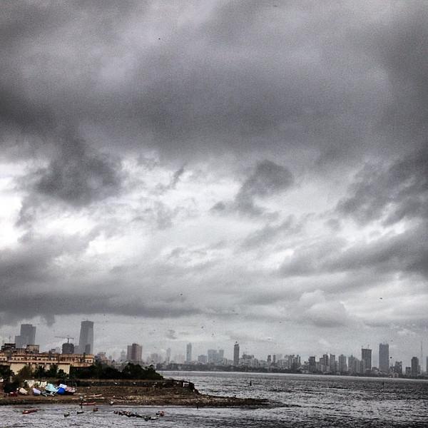 Monsoon sky, Mumbai skyline via Mahim Beach and Bandra flyover #skyporn
