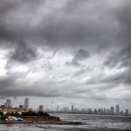 Monsoon sky, Mumbai skyline via Mahim Beach and Bandra flyover #skyporn