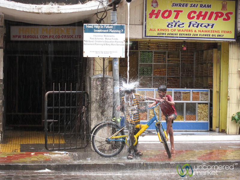 Mumbai Monsoon, Kid Playing in the Rain - Mumbai, India