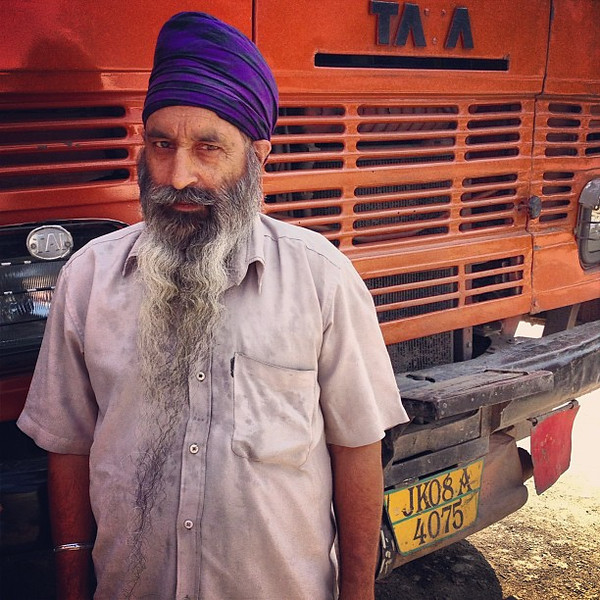 Punjabi Trucker: This man possesses an extraordinarily long beard that runs to the bottom of the frame. What's cooler still -- when we met him, he insisted out of pride that we photograph him in full view of the front of his truck, pointing to the license