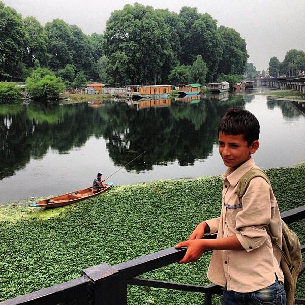 A Boy on the Bridge, a glimpse of Kashmir. Dal Gate, Srinagar