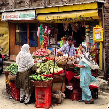 Colorful corner market. Check out the signs. Old Town Srinagar, #Kashmir