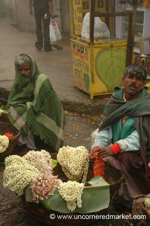 Selling Flowers in the Rain and Cold - Kodaikanal, India