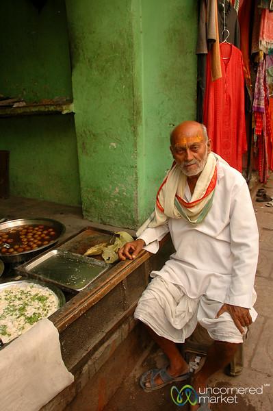Hindu Pilgrim Stopping For a Snack - Varanasi, India