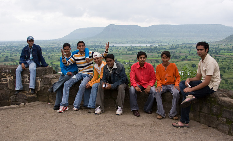 A group of friends taking a break on the hike up to the top of the abandoned fortress/city of Daulatabad.<br /> <br /> The guy on the right is either not enjoying himself or doesn't appreciate my taking his picture.<br /> <br /> Location: Daulatabad, India<br /> <br /> Lens used: 28-135mm f3.5-5.6 IS