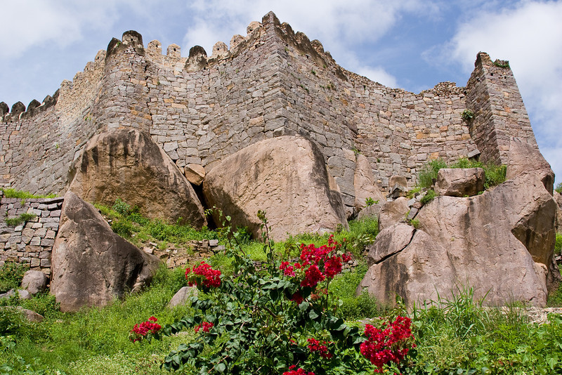 Golconda fort.<br /> <br /> Do you suppose invaders storming the castle stopped to admire the blooming Bougainvillea?  No, probably not...<br /> <br /> Location: Hyderabad, India<br /> <br /> Lens used: 28-135mm f3.5-5.6 IS