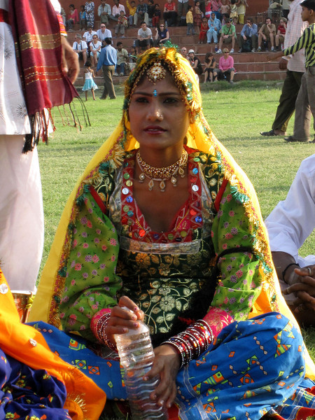An Indian dancer rests before her performance.