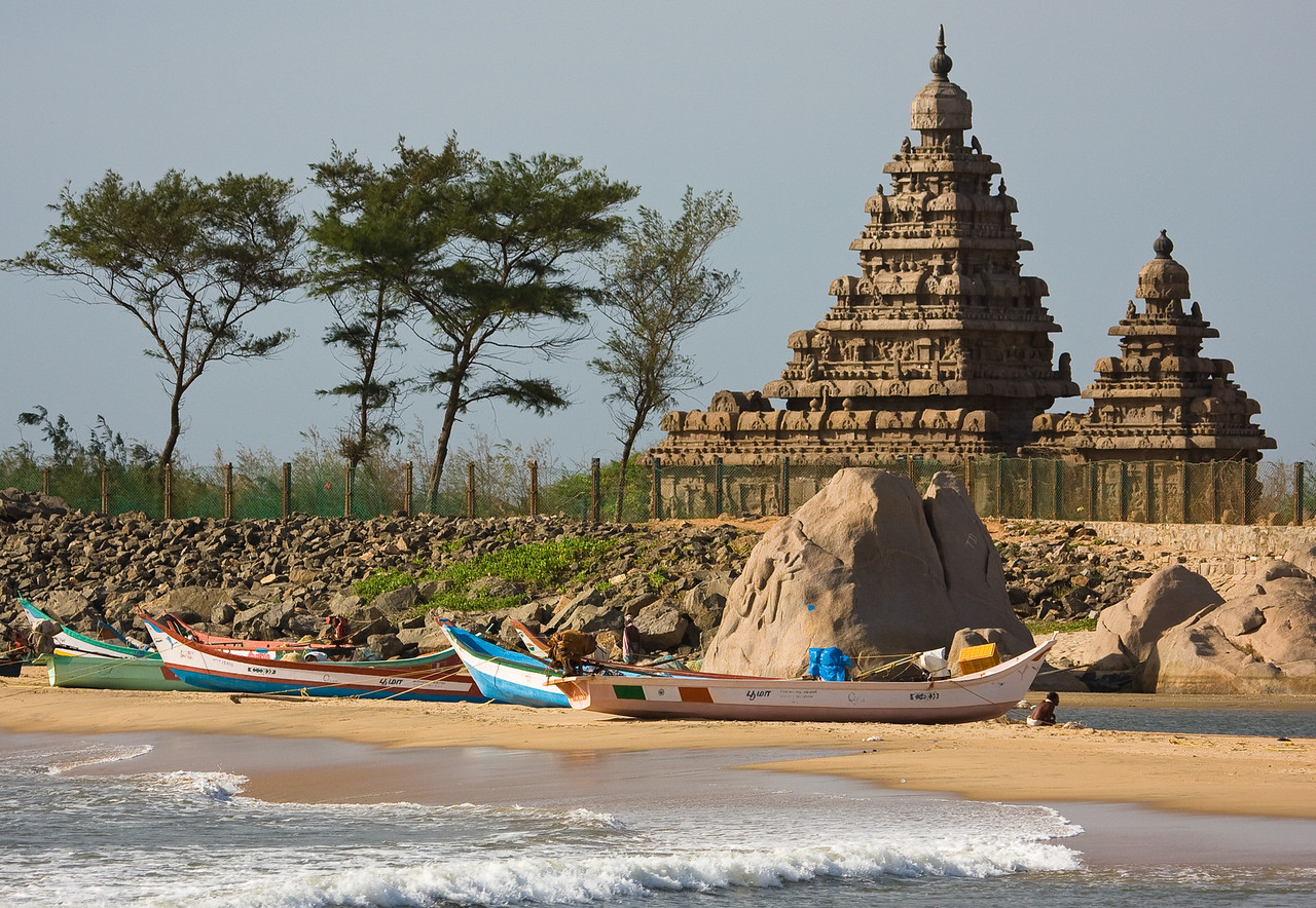 Locals' fishing boats moored on the beach with the fenced-off Shore Temple behind.<br /> <br /> Location: Mamallapuram, India<br /> <br /> Lens used: 100-400mm f4.5-5.6 IS