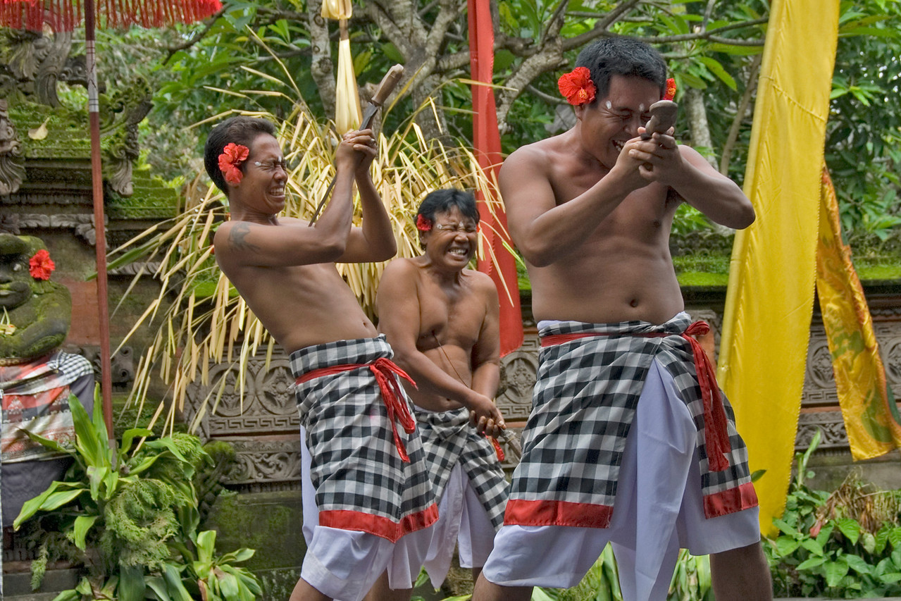 Performers stabbing themselves during Barong dance in Bali
