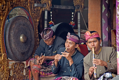 Musicians playing on a flute during Barong Dance performance in Bali, Indonesia