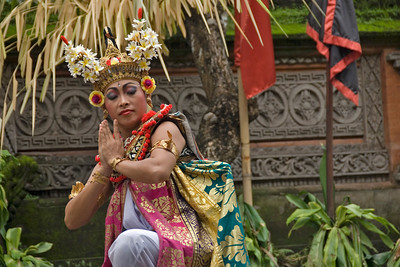 Female performer doing the Barong dance in colorful costume