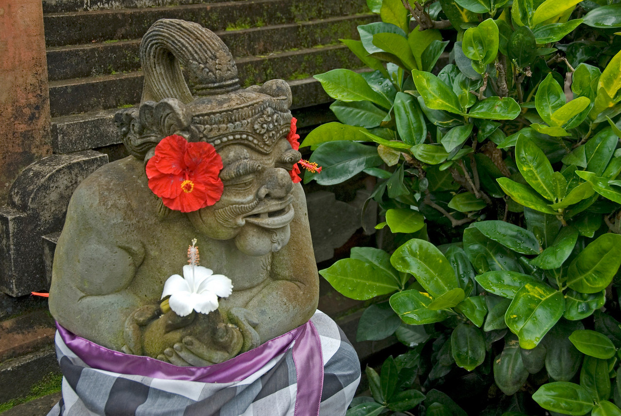 Balinese Statue with flowers spotted in Bali, Indonesia