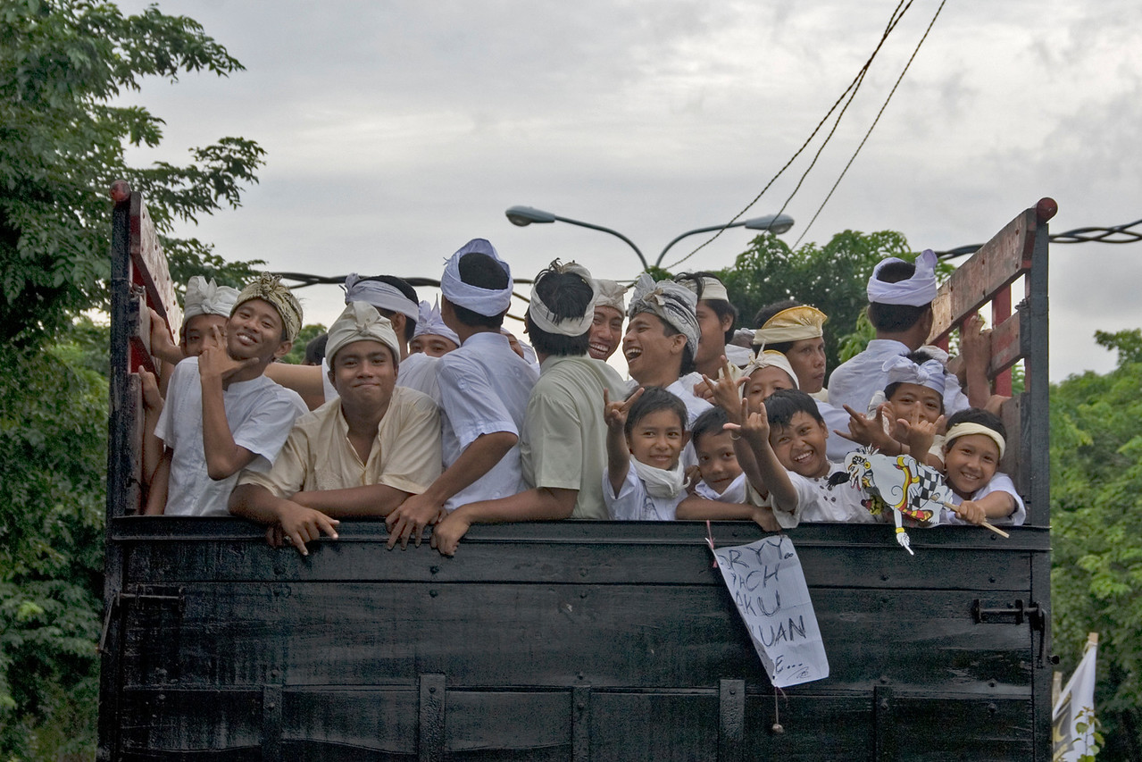 Boys loaded in the back of truck in Bali, Indonesia