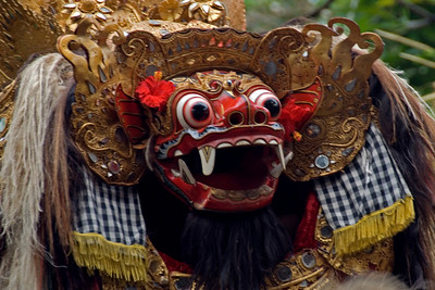 Creepy but colorful Barong face during performance in Bali