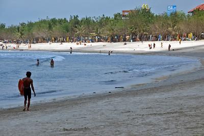 Beautiful Kuta Beach shoreline filled with tourists in Bali