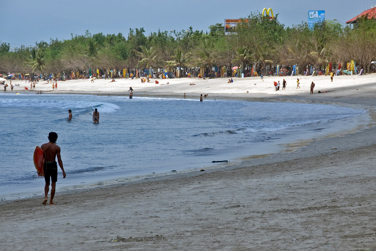 Beautiful Kuta Beach shoreline filled with tourists in Bali