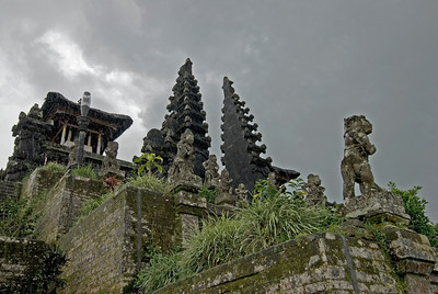 Light rain falling on statues at the Mother Temple of Besakih in Bali
