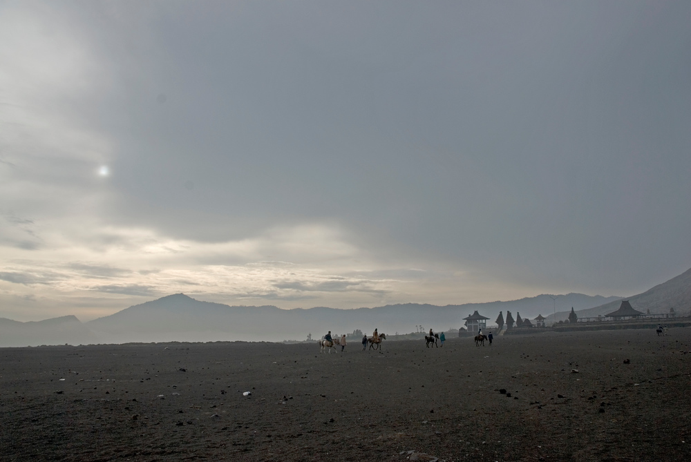 Horsemen in the crater of the Bromo Volcano, Indonesia