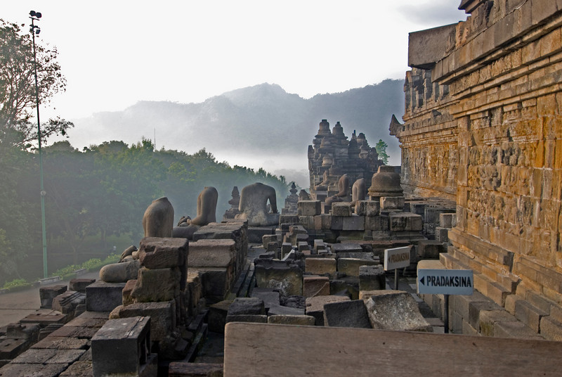 Shot of the ruins and headless statues at Borobudur temple in Java, Indonesia