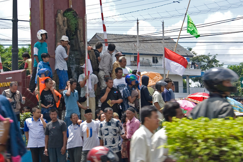 Locals standing by to watch the Suharto Funeral convoy pass by