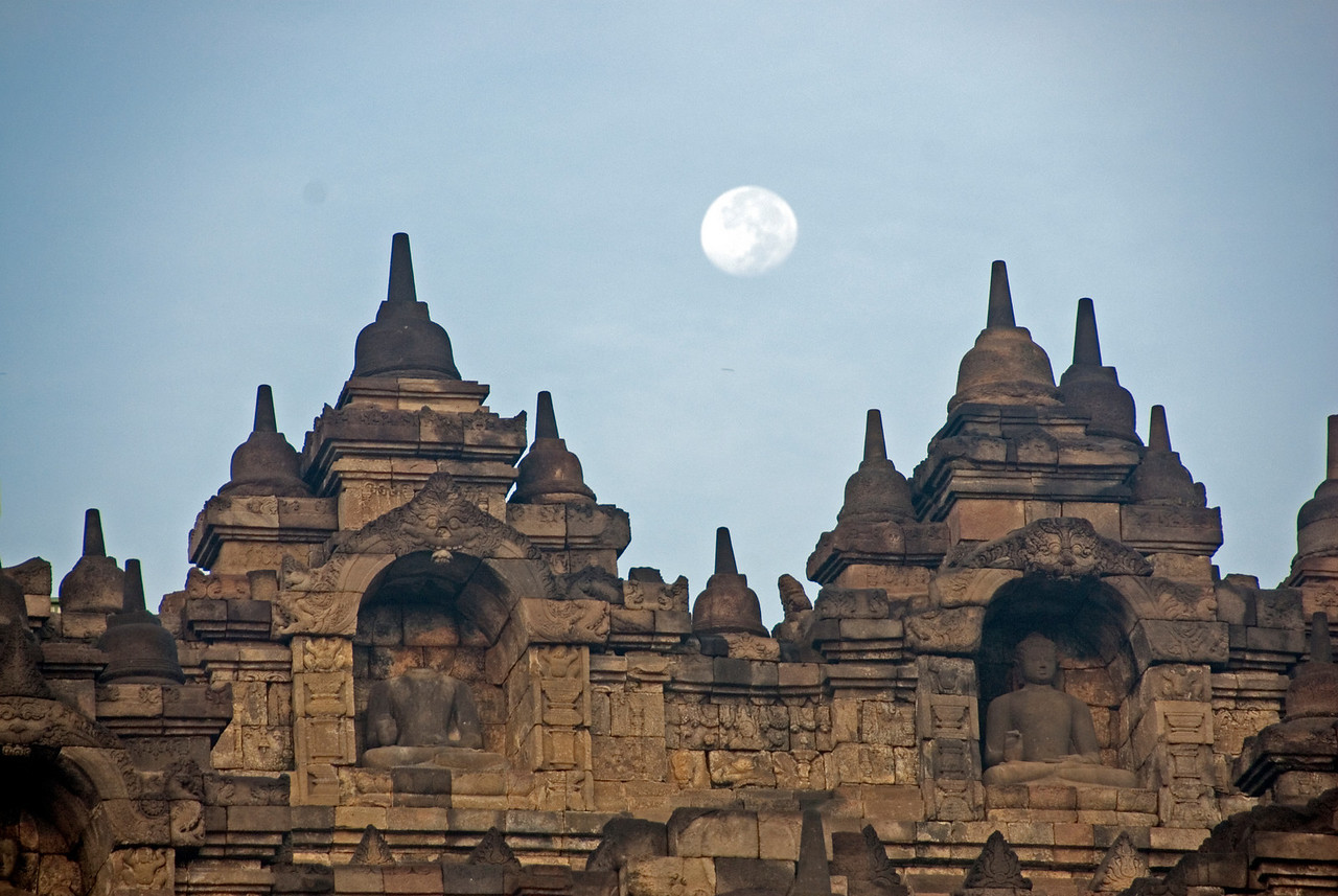 Beautiful full moon behind the towers at Borobudur in Java, Indonesia