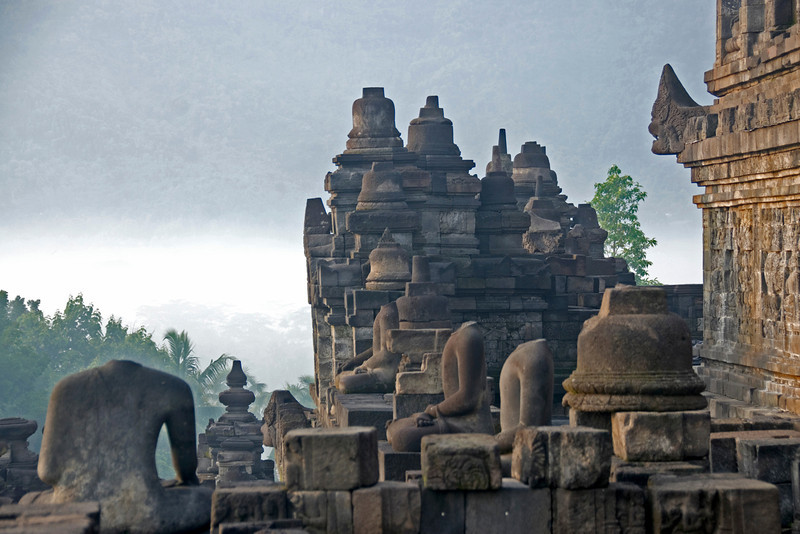 Headless statues atop the ruins in Borobudur in Java, Indonesia