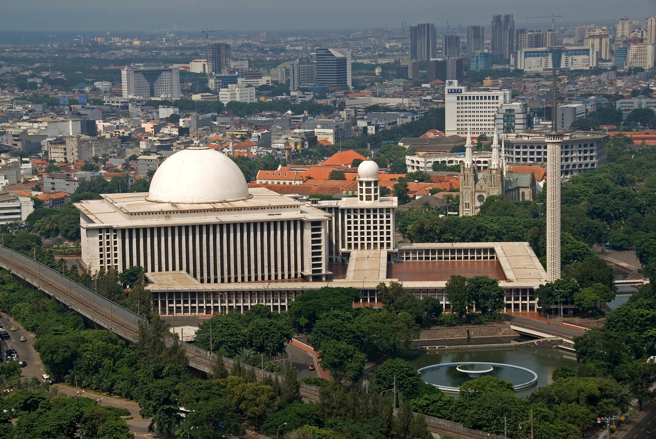 Overlooking shot of the National Mosque and city of Jakarta, Indonesia